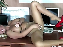 Blonde Rubs Herself Through Pantyhose