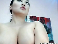 Busty Asian babe teasing on webcam