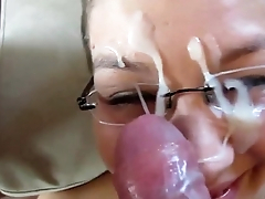 MILF with glasses takes a facial