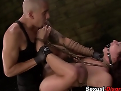 Busty slave throats cock