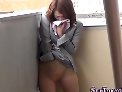 Asian hottie rubs pussy