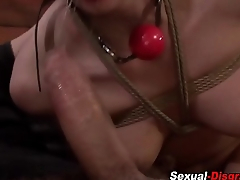 Tied up sub gags on dick